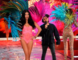 Model and Victoria's Secret Angel Adriana Lima from Brazil walks the runway while singer The Weeknd performs during the 2015 Victoria's Secret Fashion Show at Lexington Avenue Armory on November 10, 2015 in New York City.  (Photo by Dimitrios Kambouris/Getty Images for Victoria's Secret)