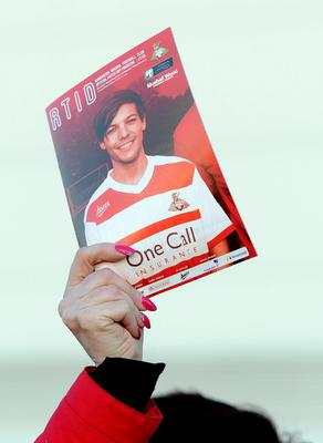 The matchday programme featuring One Direction's Louis Tomlinson outside the Keepmoat Stadium, Doncaster where he was making his debut for the reserves