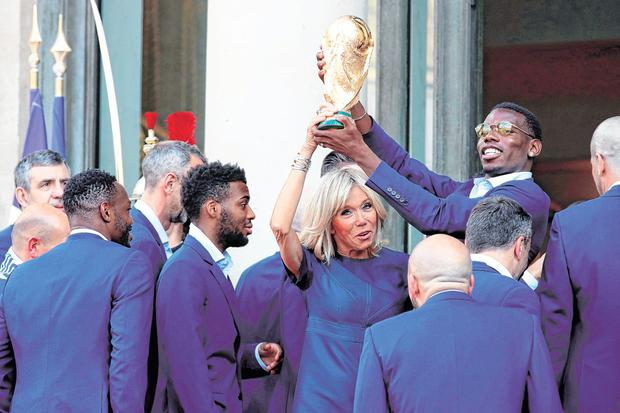 France's first lady Brigitte Macron takes hands-on approach to the World Cup with Paul Pogba. Photo: Philippe Wojazer/Reuters