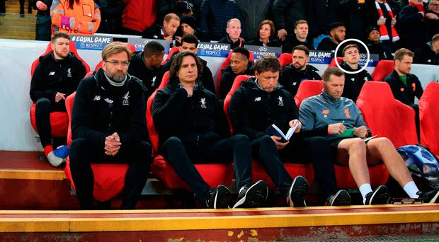 Conor Masterson (circled) watches on from the Liverpool bench ahead of last night's game