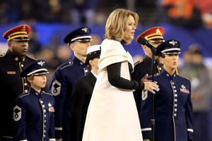 Opera singer Renee Fleming sings the national anthem before the Seattle Seahawks take on the Denver Broncos during Super Bowl XLVIII at MetLife Stadium on February 2, 2014 in East Rutherford, New Jersey.