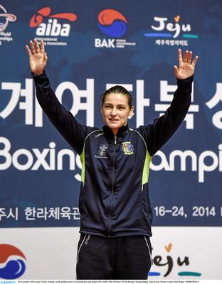 24 November 2014; Katie Taylor, Ireland, on the podium prior to receiving her gold medal. 2014 AIBA Elite Women's World Boxing Championships, Jeju, Korea. Picture credit: Paul Mohan / SPORTSFILE