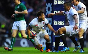 England scrum half  Danny Care celebrates after scoring the first England try with Billy Twelvetrees (r) and Luther Burrell (2nd right)