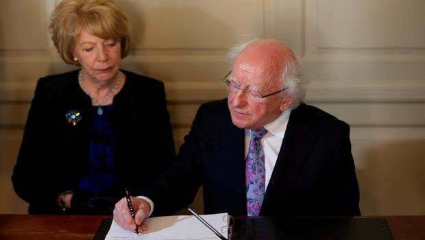 President Michael D Higgins and his wife Sabina sign a book of condolence at Mansion House in Dublin for those killed in the Berkeley balcony collapse. Niall Carson/PA Wire