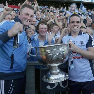 Dublin player Ger Brennan celebrates with the Sam Maguire Cup and Dublin supporters after victory over Mayo in the All Ireland Football Final Croke Park. Picture credit; Damien Eagers / Irish Independent 22 September 2013