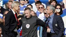 Jose Mourinho and Arsene Wenger are kept apart by the fourth official Jonathan Moss in their league clash in October 2014 at Stamford Bridge. Photo: ADRIAN DENNIS/AFP via Getty Images
