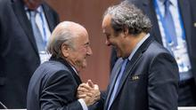 FIFA president Sepp Blatter after his election as President greeted by UEFA President Michel Platini, right, at the Hallenstadion in Zurich, Switzerland