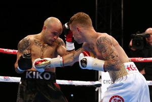 Carl Frampton (right) in action against Kiko Martinez during their IBF World Super Bantamweight Championship fight in the Titanic Quarter, Belfast. PRESS ASSOCIATION Photo. Picture date: Saturday September 5, 2014. Photo credit should read: Niall Carson/PA Wire