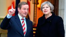 Taoiseach Enda Kenny greets Britain's Prime Minister Theresa May at Government Buildings in Dublin. Photo: Gerry Mooney