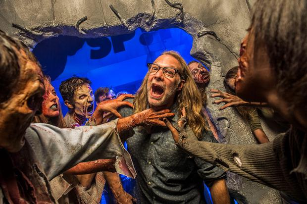 """ORLANDO, FL: Greg Nicotero, Co-Executive Producer and Director of Special Effects Make-Up Artist for AMC's """"The Walking Dead,"""" found himself surrounded by a horde of walkers at Universal Orlando's Halloween Horror Nights 24 in 2014. Photo by Roberto Gonzales/Universal Orlando via Getty Images"""