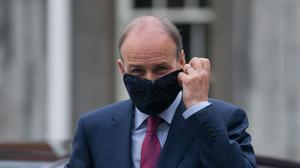 Masked man: Taoiseach Micheál Martin arrives for a Cabinet meeting at Dublin Castle. Photo: Gareth Chaney, Collins