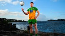 Donegal's Jamie Brennan looks ahead to this weekend's Allianz NFL clash with Galway while taking in the scenery at Donegal Harbour. Photo: Sam Barnes/Sportsfile