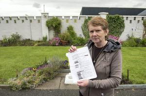 Historian Catherine Corless with the report on the Tuam babies from 1947. Photo: Andrew Downes