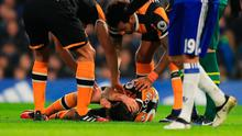 Ryan Mason of Hull City lies injured after the collision with Gary Cahill. Photo: Getty