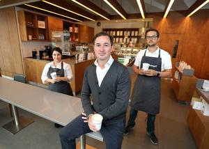 Karl Purdy with Jessica Demelas and Martino Perlini in the Coffeeangel branch at the Exchange Building in the IFSC. Photo: Frank McGrath