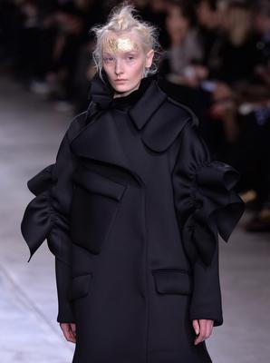 A model on the catwalk during the Simone Rocha Autumn/Winter 2014 show at Tate Modern, London.