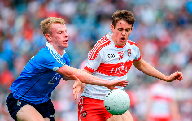Dublin's Eoin O'Dea tackles Derry's Lorcan McWilliams during the All-Ireland MFC semi-final at Croke Park. Photo by Ramsey Cardy/Sportsfile