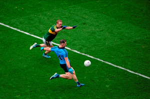 Philly McMahon turns the tables to kick a point for Dublin despite the efforts of Kerry star Colm Cooper
