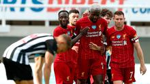 Liverpool's Divock Origi celebrates with team-mates after scoring his side's second goal of the game. Photo: PA