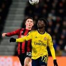Arsenal's Bukayo Saka vies for the ball with Bournemouth's Harry Wilson. Photo: Glyn Kirk/AFP via Getty Images