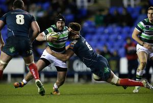 Jimmy Stevens of London Irish tackled during the LV= Cup Match between London Irish and Scarlets at the Madejski Stadium in Reading yesterday.
