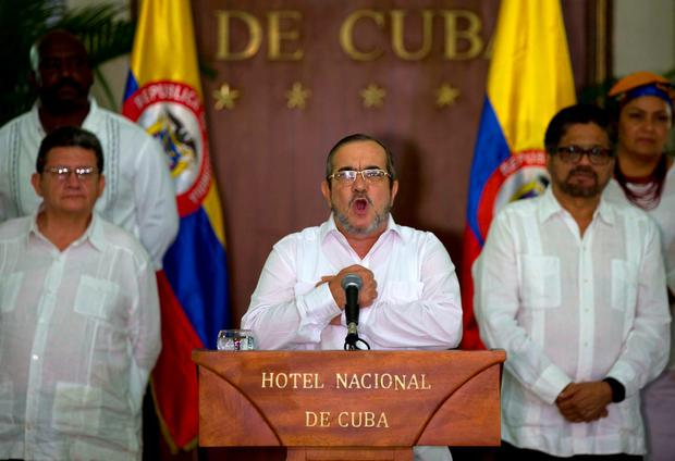 Commander of the Revolutionary Armed Forces of Colombia or FARC, Rodrigo Londono, better known as Timochenko or Timoleon Jimenez talks to the press, accompanied by Ivan Marquez, right, chief negotiator of the Revolutionary Armed Forces of Colombia and Pablo Catatumbo, left, chief of the FARC's western bloc, in Havana, Cuba, Sunday, August 28, 2016