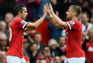 Robin van Persie celebrates with teammate Luke Shaw after scoring his team's second goal during the match between Manchester United and West Ham United at Old Trafford. Laurence Griffiths/Getty Images