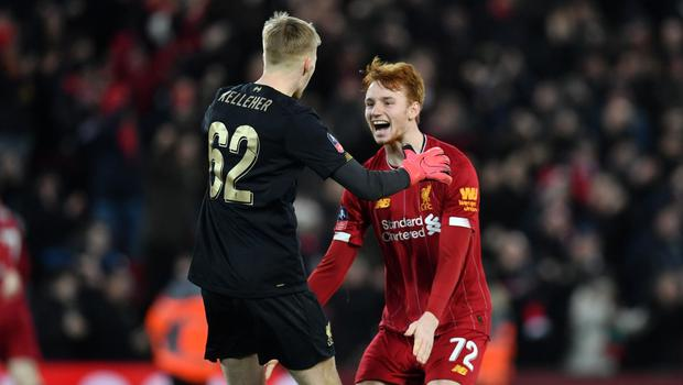Liverpool's Irish goalkeeper Caoimhín Kelleher and Dutch defender Sepp van den Berg celebrate their victory in the FA Cup against Shrewsbury