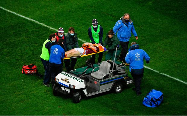 Joe Canning of Galway is assisted off the field by medical personnel during the GAA Hurling All-Ireland Senior Championship Semi-Final match between Limerick and Galway at Croke Park in Dublin. Photo by Daire Brennan/Sportsfile