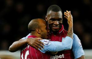 """Football - Aston Villa v West Bromwich Albion - Barclays Premier League - Villa Park - 3/3/15 Aston Villa's Christian Benteke and Fabian Delph celebrate at the end of the match Reuters / Darren Staples Livepic EDITORIAL USE ONLY. No use with unauthorized audio, video, data, fixture lists, club/league logos or """"live"""" services. Online in-match use limited to 45 images, no video emulation. No use in betting, games or single club/league/player publications.  Please contact your account representative for further details."""
