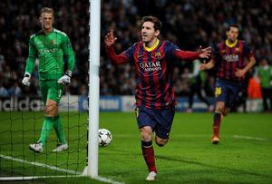 FC Barcelona's Lionel Messi celebrates scoring his teams 1st goal past Manchester City's Joe Hart