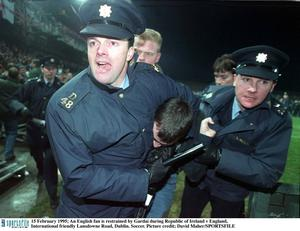 15 February 1995; An England fan is restrained by Gardai after rioting in the West Stand forced the abandonment of the game. International Friendly, Republic of Ireland v England, Lansdowne Road, Dublin. Picture credit; David Maher / SPORTSFILE