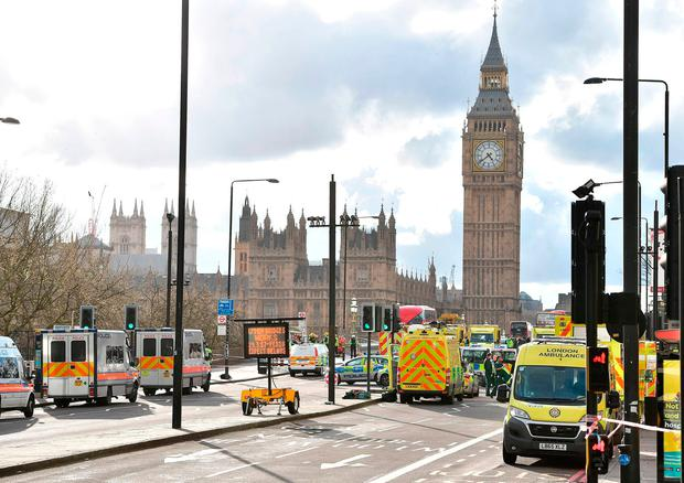 Emergency personnel on Westminster Bridge, close to the Palace of Westminster, following the attack. Photo: PA