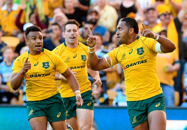 Australia's Sefa Naivalu reacts after scoring a try