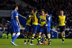 Arsenal's Tomas Rosicky (centre right) celebrates with team mates after scoring his side's third goal of the game during the FA Cup Fourth Round match at the AMEX Stadium, Brighton. PRESS ASSOCIATION Photo. Picture date: Sunday January 25, 2015. See PA story SOCCER Brighton. Photo credit should read: Gareth Fuller/PA Wire. RESTRICTIONS: Editorial use only. Maximum 45 images during a match. No video emulation or promotion as 'live'. No use in games, competitions, merchandise, betting or single club/player services. No use with unofficial audio, video, data, fixtures or club/league logos.