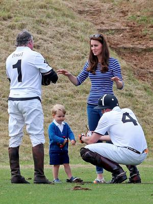 TETBURY, ENGLAND - JUNE 14:  Prince William, Duke of Cambridge talks to his son Prince George of Cambridge with Catherine, Duchess of Cambridge at the Gigaset Charity Polo Match at Beaufort Polo Club on June 14, 2015 in Tetbury, England.  (Photo by Chris Jackson/Getty Images)