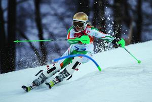 SOCHI, RUSSIA - FEBRUARY 21:  Florence Bell of Ireland in action during the Women's Slalom during day 14 of the Sochi 2014 Winter Olympics at Rosa Khutor Alpine Center on February 21, 2014 in Sochi, Russia.  (Photo by Clive Rose/Getty Images)