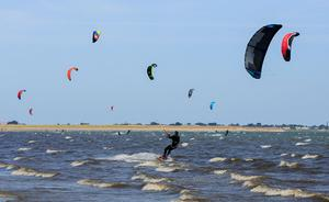 Riding the waves: Kitesurfers enjoying the good weather at Dollymount, Dublin, yesterday. Photo: Gareth Chaney/Collins