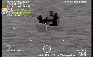 A rescue vessel is seen during the search and rescue operation underway after a boat carrying migrants capsized overnight, with up to 700 feared dead, in this still image taken from video released by Italian Guardia di Finanza April 19, 2015. REUTERS/Guardia di Finanza/Handout via Reuters