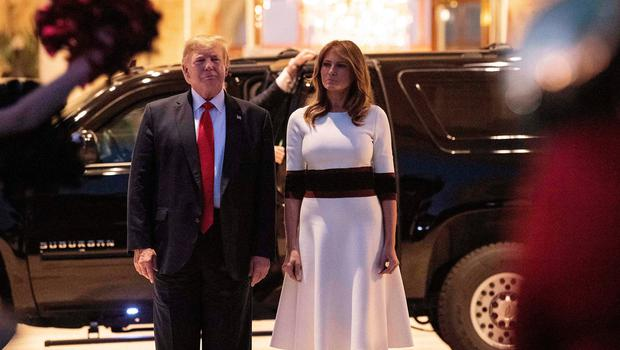 On parade: Mr Trump and his wife Melania watch a military band at a party for the Superbowl at his Mar-a-Lago property in Florida. Photo: NICHOLAS KAMM/AFP via Getty Images