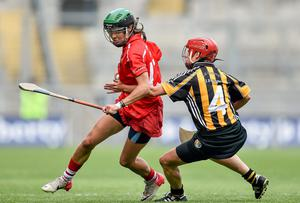 Cork's Julia White goes past Jacqui Frisby, Kilkenny. Picture credit: Ramsey Cardy / SPORTSFILE
