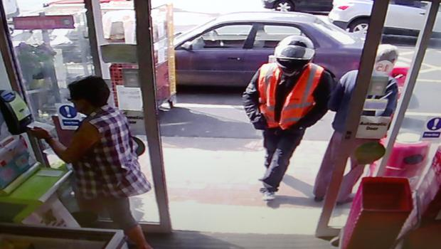 FROM CCTV....The lone raider arrives at The Glasnevin Avenue Spar.