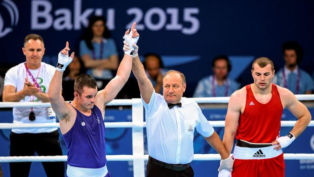 16 June 2015; Darren O'Neill, Ireland, is announced victorious over Ionut Jitaru, Romania, during their Men's Boxing Heavy 91kg Round of 32 bout. 2015 European Games, Crystal Hall, Baku, Azerbaijan. Picture credit: Stephen McCarthy / SPORTSFILE