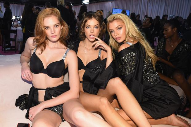 Alexina Graham, Barbara Palvin and Stella Maxwell prepare backstage during the 2018 Victoria's Secret Fashion Show in New York at Pier 94 on November 8, 2018 in New York City.  (Photo by Dimitrios Kambouris/Getty Images for Victoria's Secret)