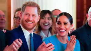 Britain's Prince Harry and Meghan Markle celebrated the work of the British military  (Photo by Paul Edwards - WPA Pool/Getty Images)