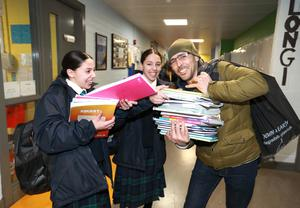 Ready to go:  Ayoub Amer helps his twin daughters Rayhana and Ikram (13) as they collect  school books in Coláiste Bríde in Clondalkin, Dublin, before the enforced school closure.  Photo: Frank McGrath