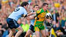 Donegal's David Walsh is tackled by Dublin's Michael Darragh Macauley, left, and Alan Brogan during the All-Ireland SFC semi-final at Croke Park back in August 2011. Photo: Paul Mohan/Sportsfile