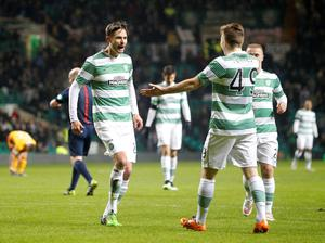 Celtic's Mikael Lustig celebrates alongside teammate James Forrest