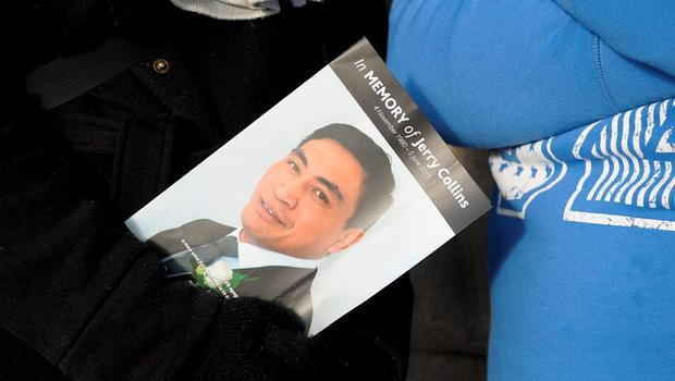 A member of the public holds the funeral program before the service for Jerry Collins at Te Rauparaha Arena in Porirua, New Zealand.