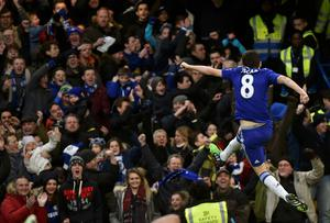 Chelsea's Oscar celebrates his goal in front of fans at Stamford Bridge